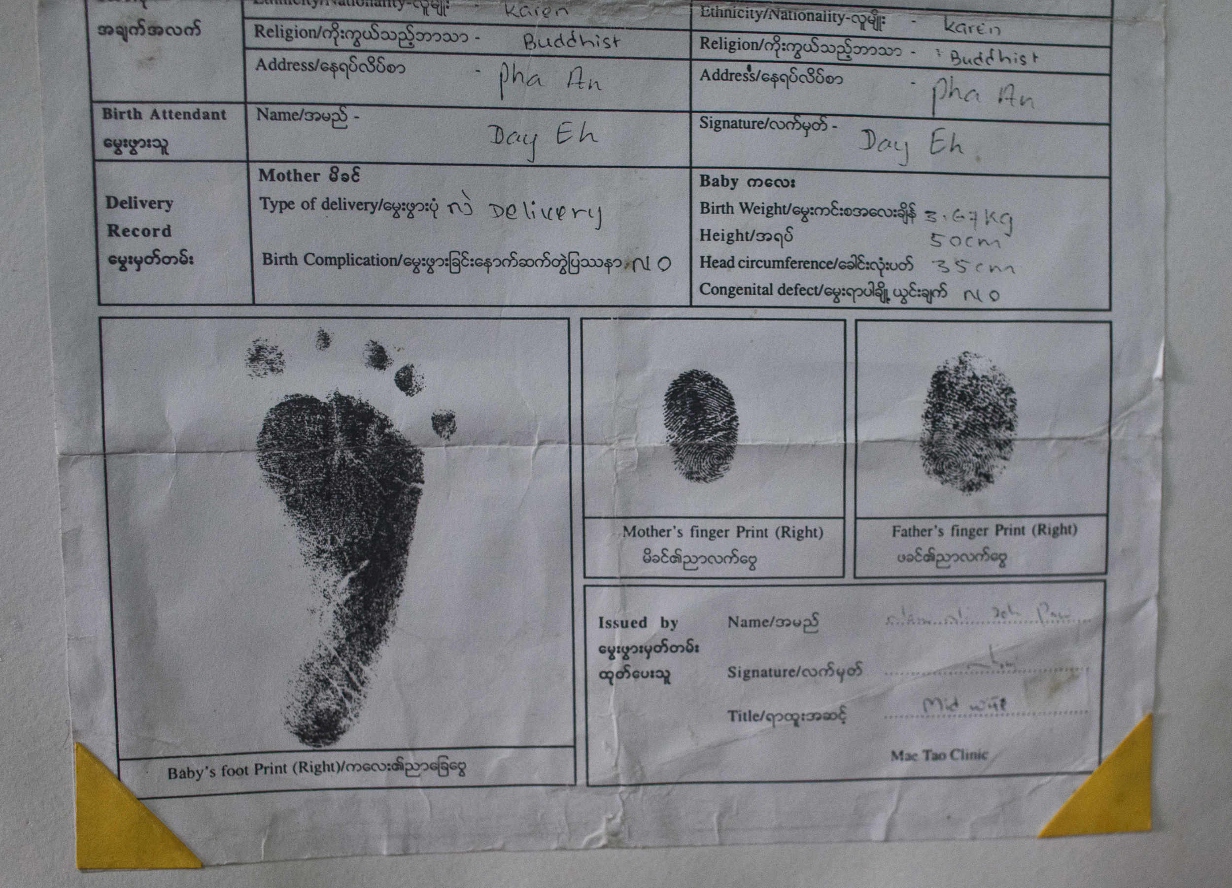 Burmese Family Registers Their Child For A Birth Certificate As Part