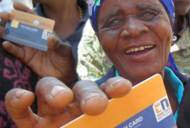 Woman holding a beneficiary card