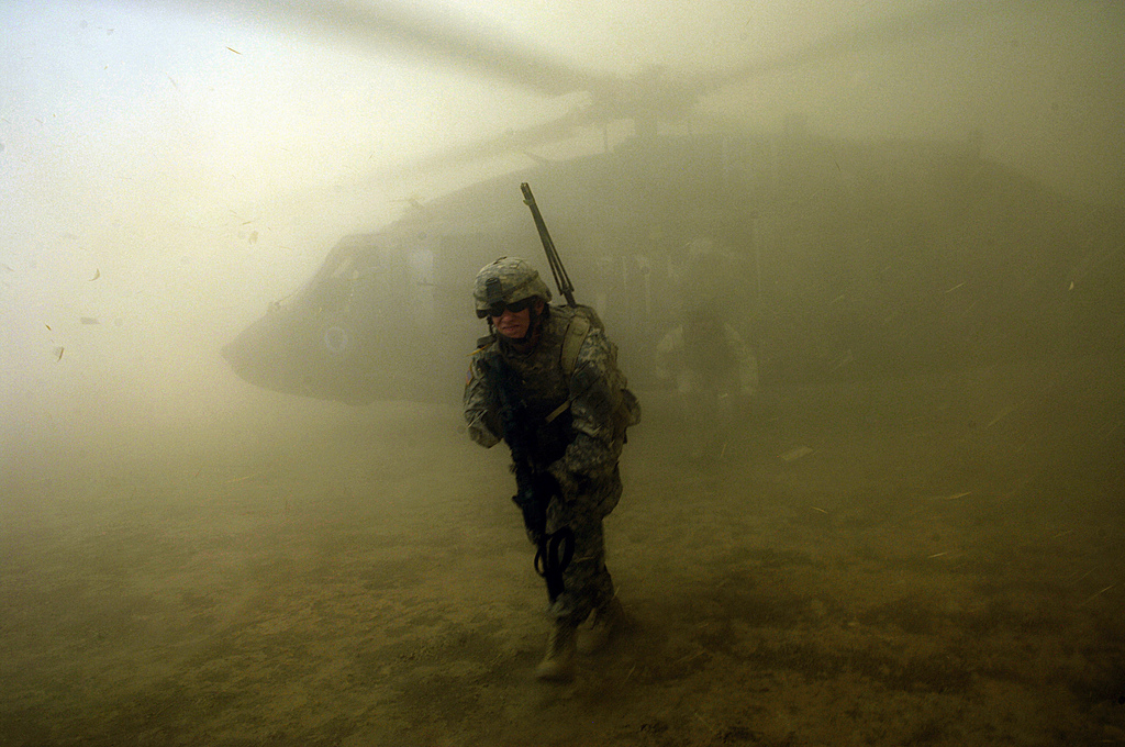 US Army soldiers exit a UH-60 Black Hawk during an aerial traffic control point mission near Tall Afar, Iraq