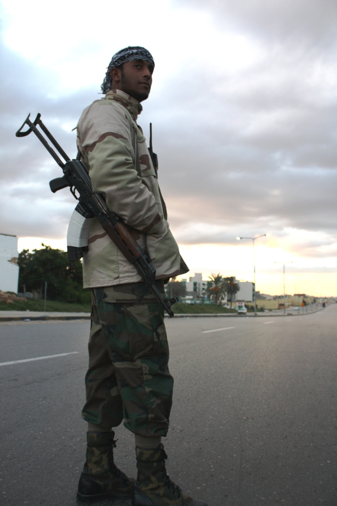 A Libyan revolutionary blocks off a road during a demining operation in Tripoli in November 2011