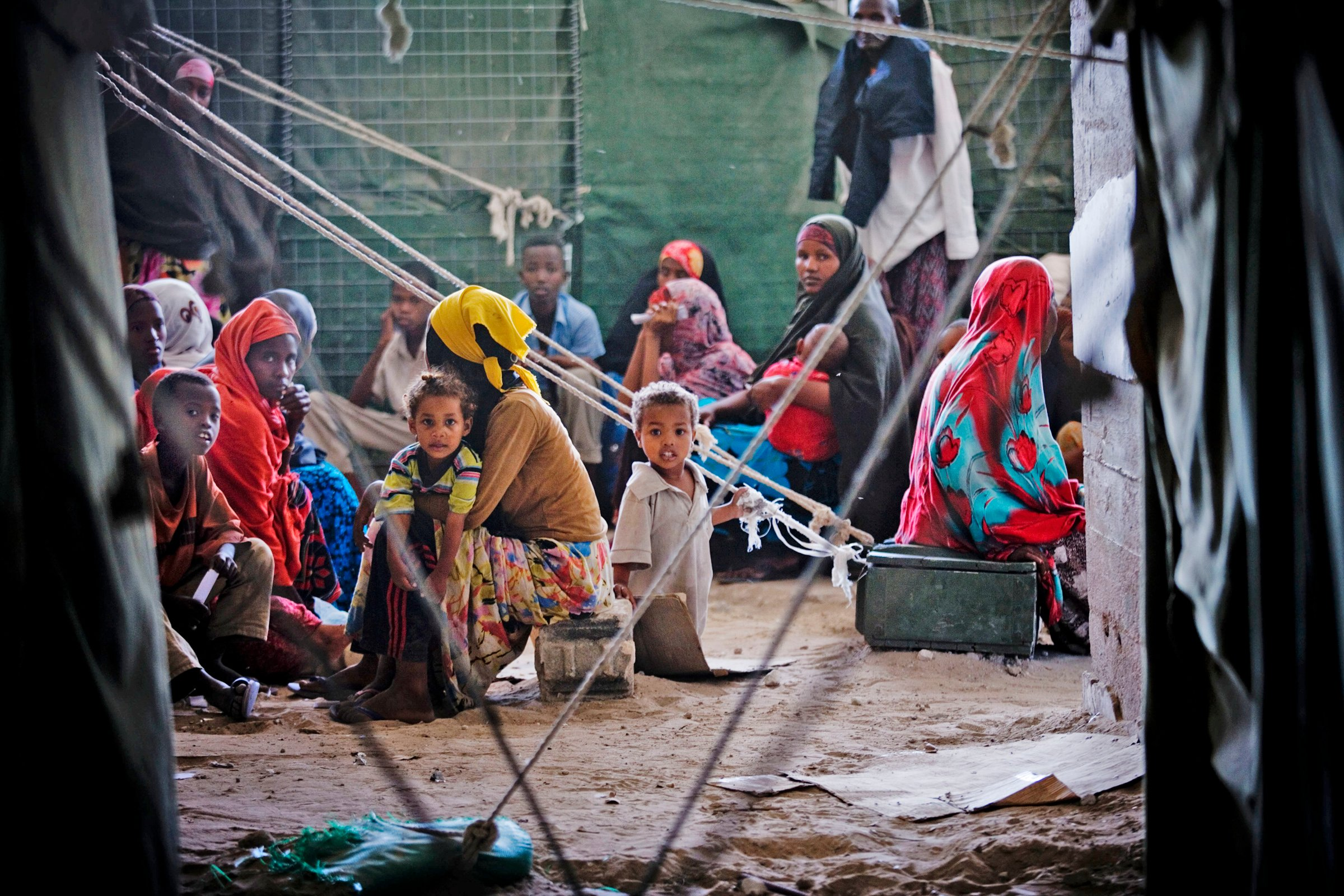 Women and children await treatment at Outpatients Unit run by AMISOM in the  Aruba Hotel, Mogadishu, Somalia