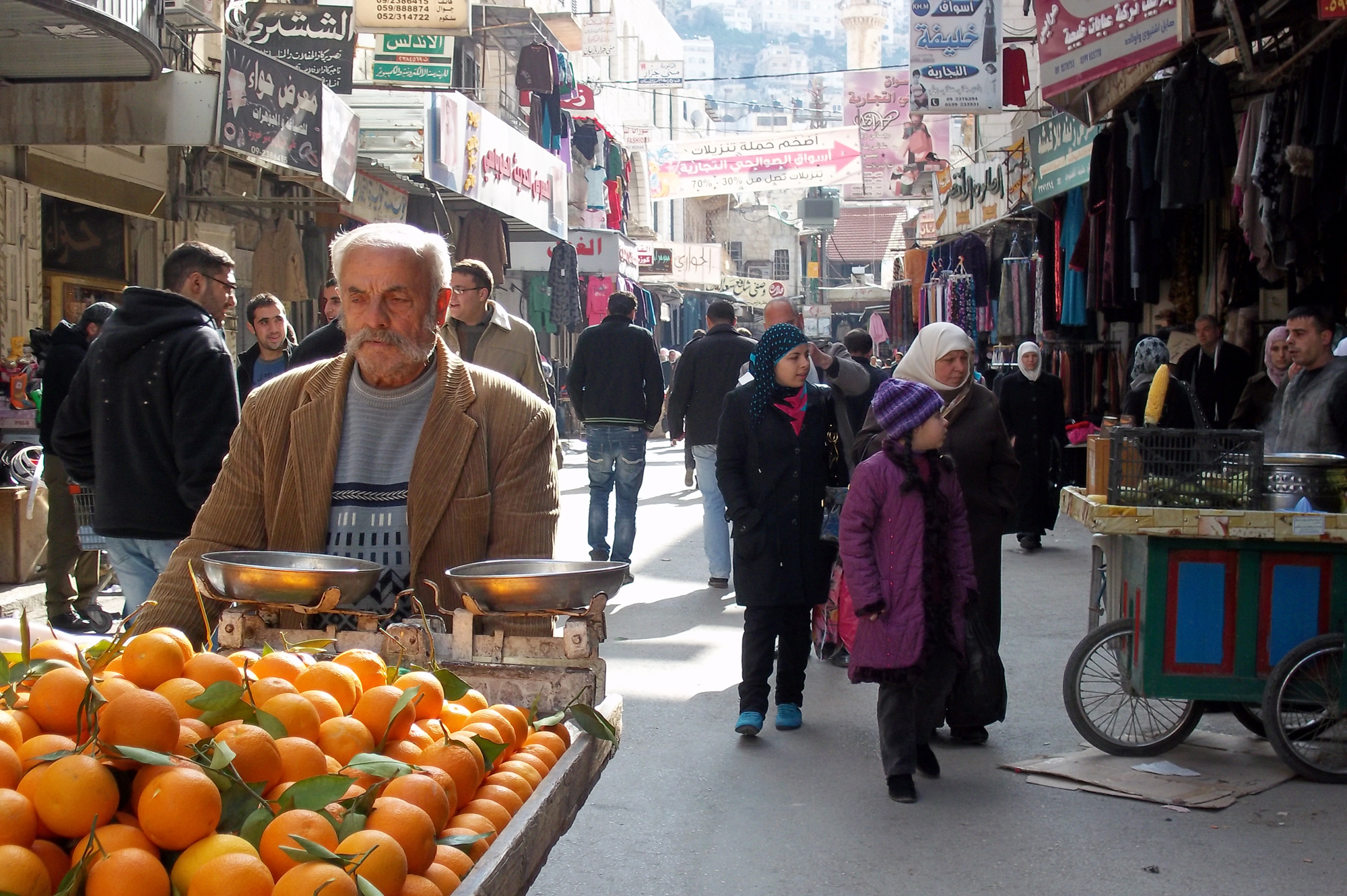 Palestinian man selling oranges in the Old City of Nablus. Despite some economic growth reported in the West Bank in 2011, purchasing power remains low. Unemployment in the West Bank hovers at 24 percent, according to the UN