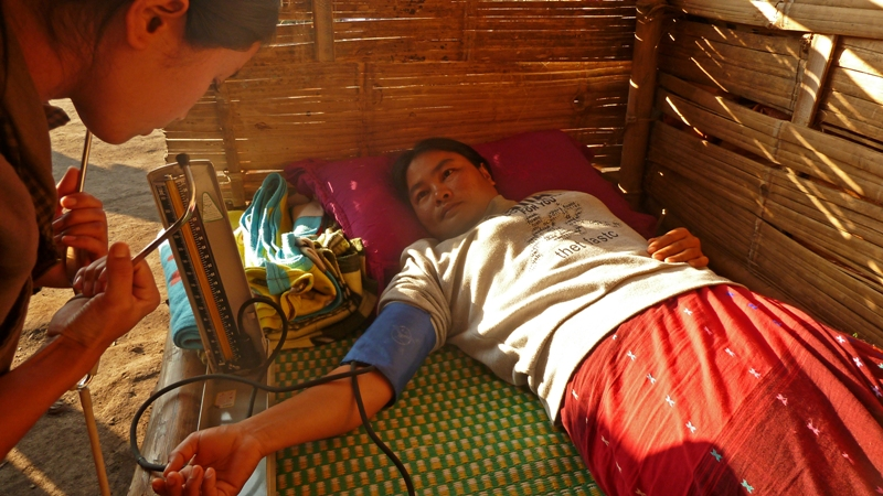 A woman receives treatment at an IDP camp outside of Laiza in Myanmar's northern Kachin State. More than 40,000 people fled their homes following the collapse of a 17-year-old ceasefire between government forces and the Kachin Independence Army