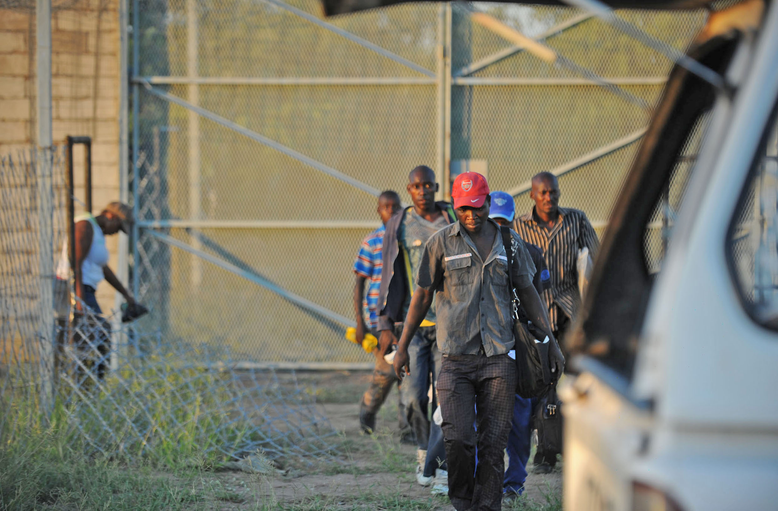 A group of illegal migrants find easy access through an open gate in the border fence between Zimbabwe and South Africa, about 25km west of the Beitbridge border post (Feb 2012)
