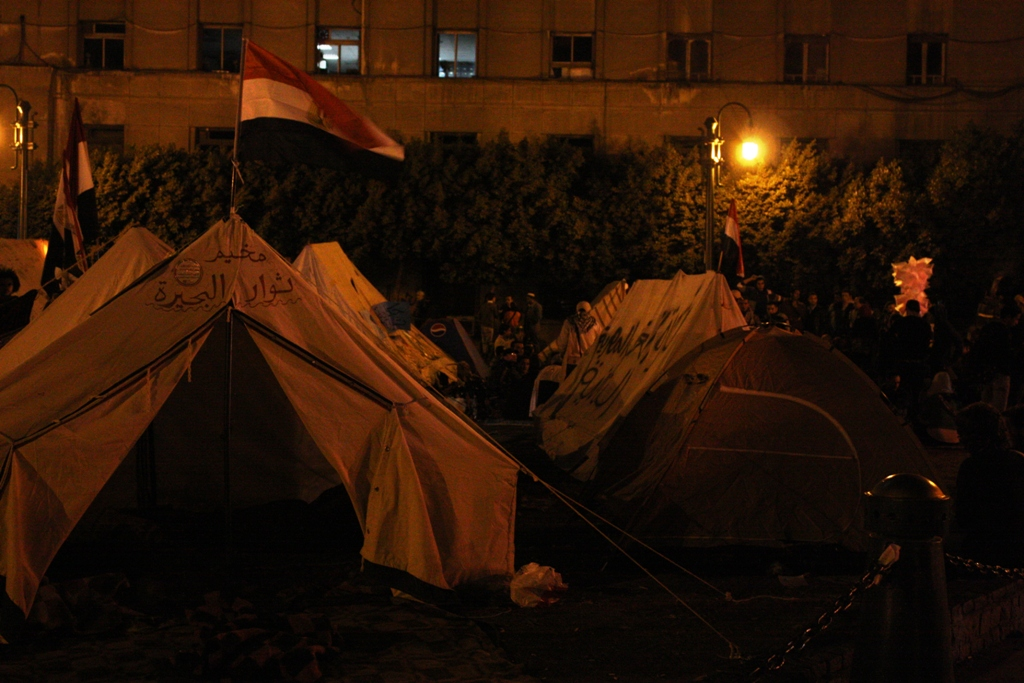 After renewed clashes between security services and protesters in Egypt, a tent city was resurrected in Cairo's central Tahrir Square in November 2011 to push the ruling military council to hand over power to a civilian government immediately