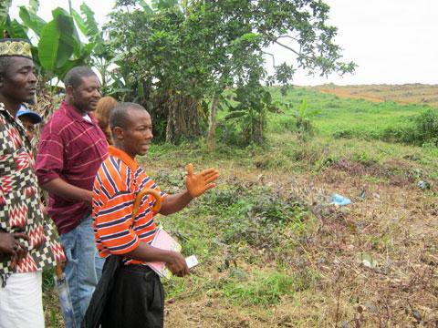 Residents viewing the land they say was seized for foreign investors
