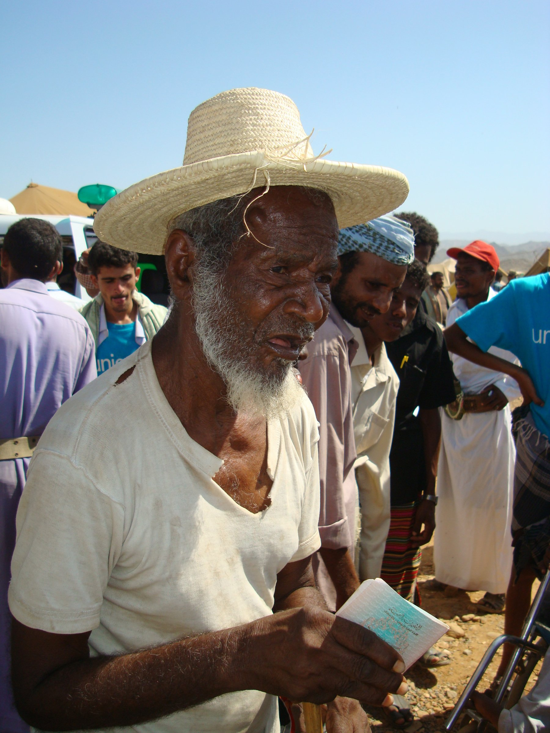An elderly IDP holds his voting card in Haradh District, north Yemen. Some 70 families are reported to have fled to Haradh due to clashes between Houthis and Salafis