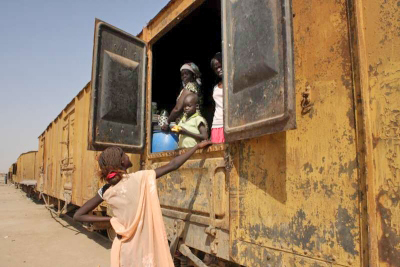 After waiting for over a year to go to South Sudan, some southerners have set up home in abandoned train carriages at Khartoum's Shajara railway station