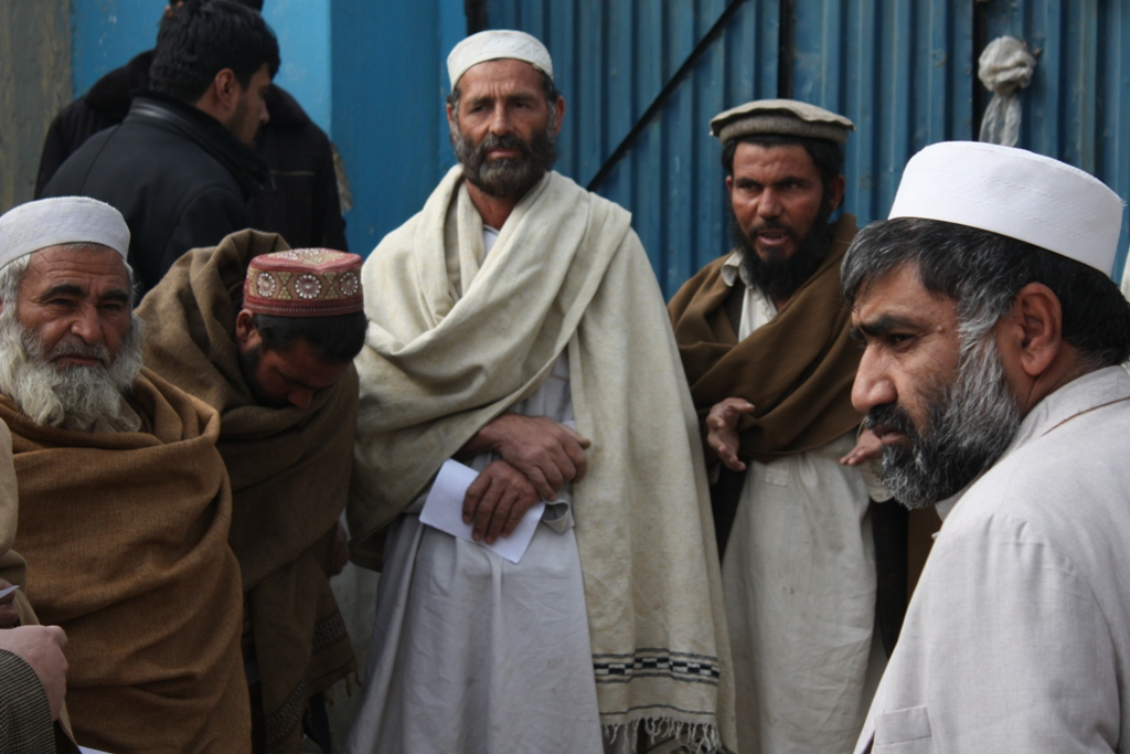 "Vulnerable Afghan returnees (refugees who recently returned from Pakistan) line up to receive ""winterization"" packages to help them cope with the harsh winter at a distribution point in Jalalabad, eastern Afghanistan"