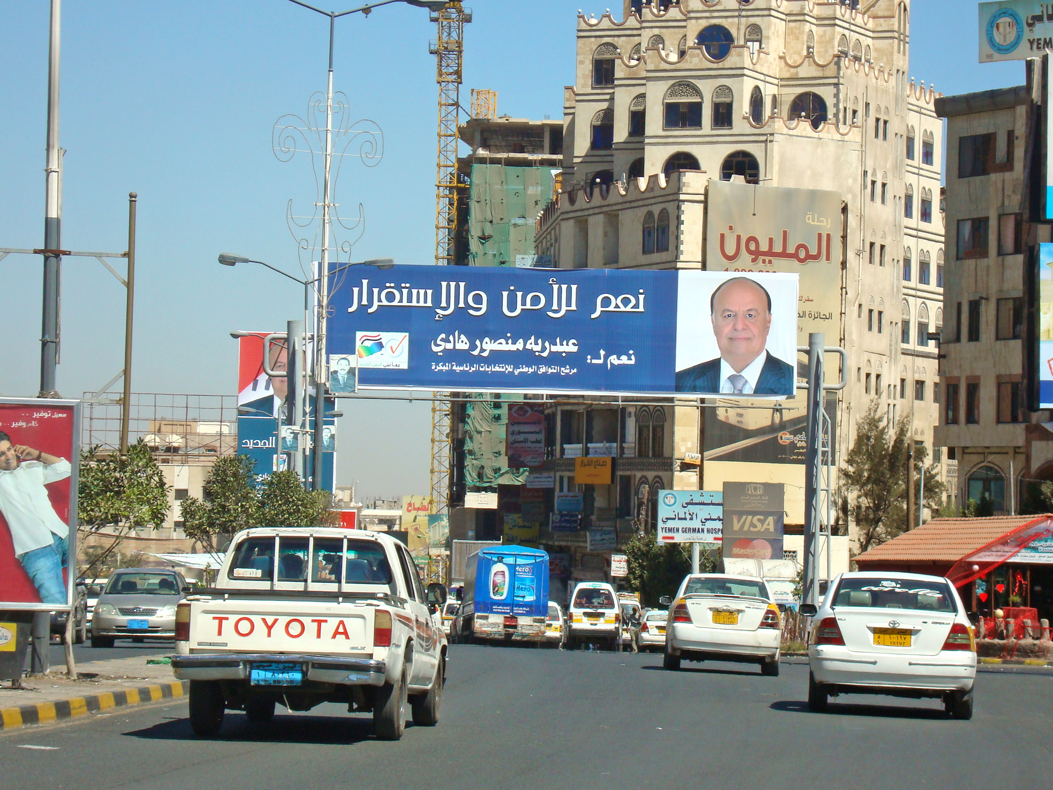 "A banner for sole Yemeni presidential candidate Hadi in the January 2012 elections saying ""Yes to Security and Stability"""