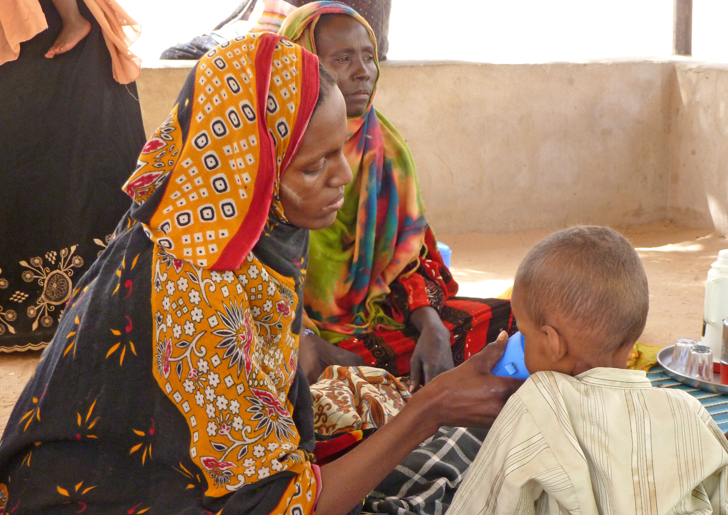 A mother feeds her severely malnourished son at the Action Against Hunger/UNICEF-run nutrition feeding centre at Mao district hospital in Kanem, western Chad