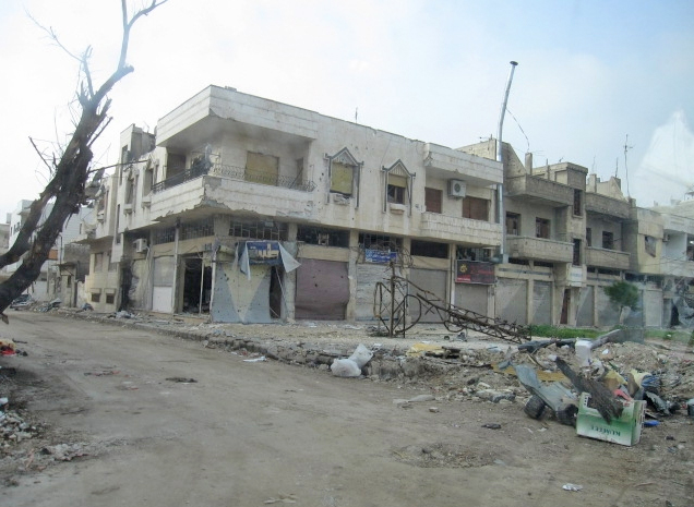 "The city of Homs in Syria has been extensively damaged by government shelling of ""terrorists"" (March 2012)"