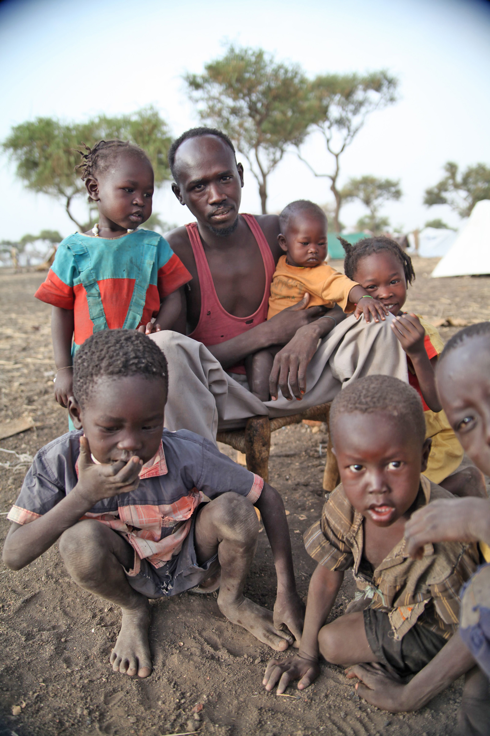 Hamid Yussef Bashir with his five children at a camp in Jamam in South Sudan's Upper Nile state