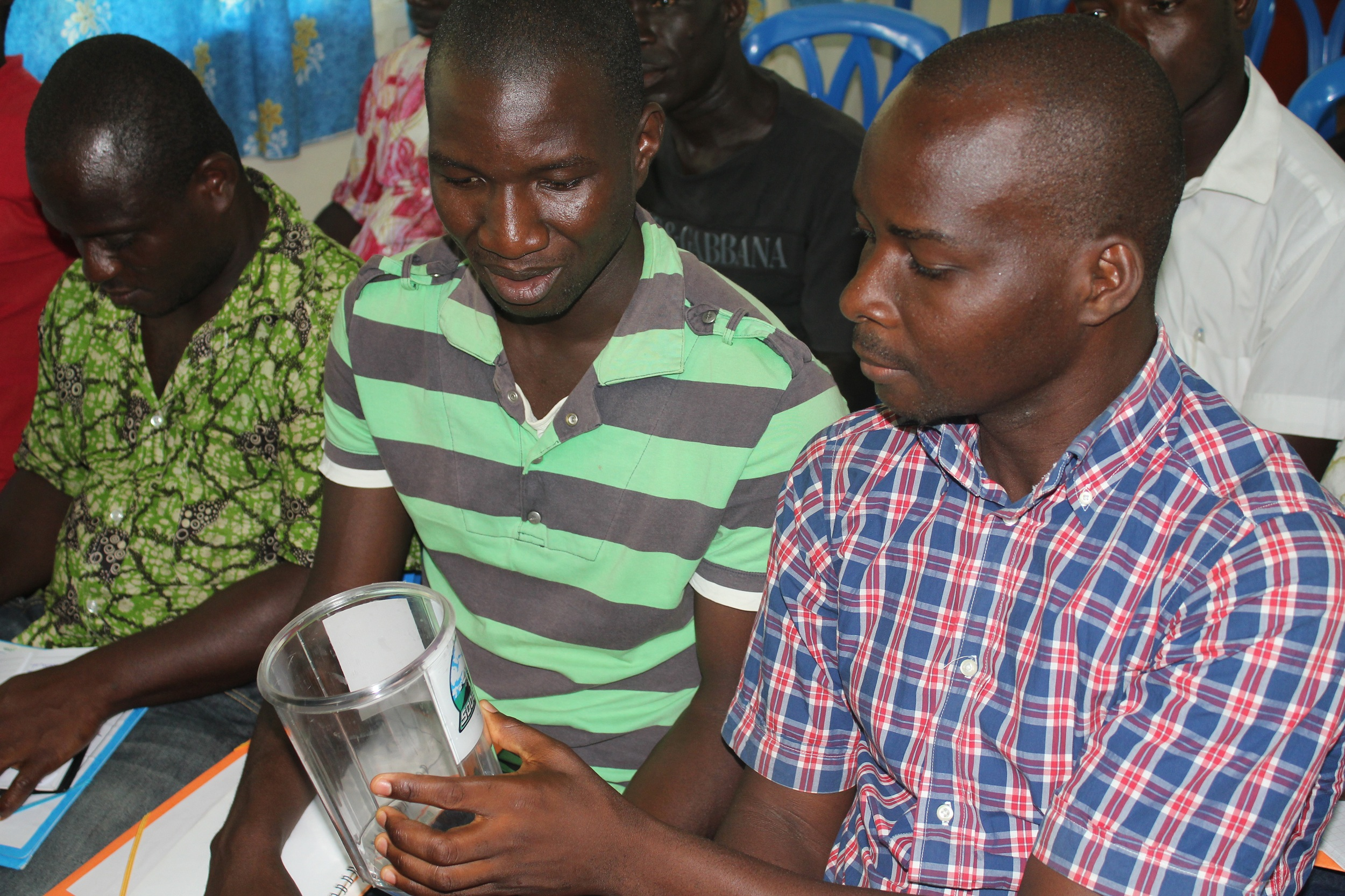 Farmers from all over the country gather in Bingerville to learn how to access accurate weather forecast information and how to measure rainfall by using rain gauges. Rainfall in Cote d'Ivoire has dropped 15 percent in a decade according to the National W