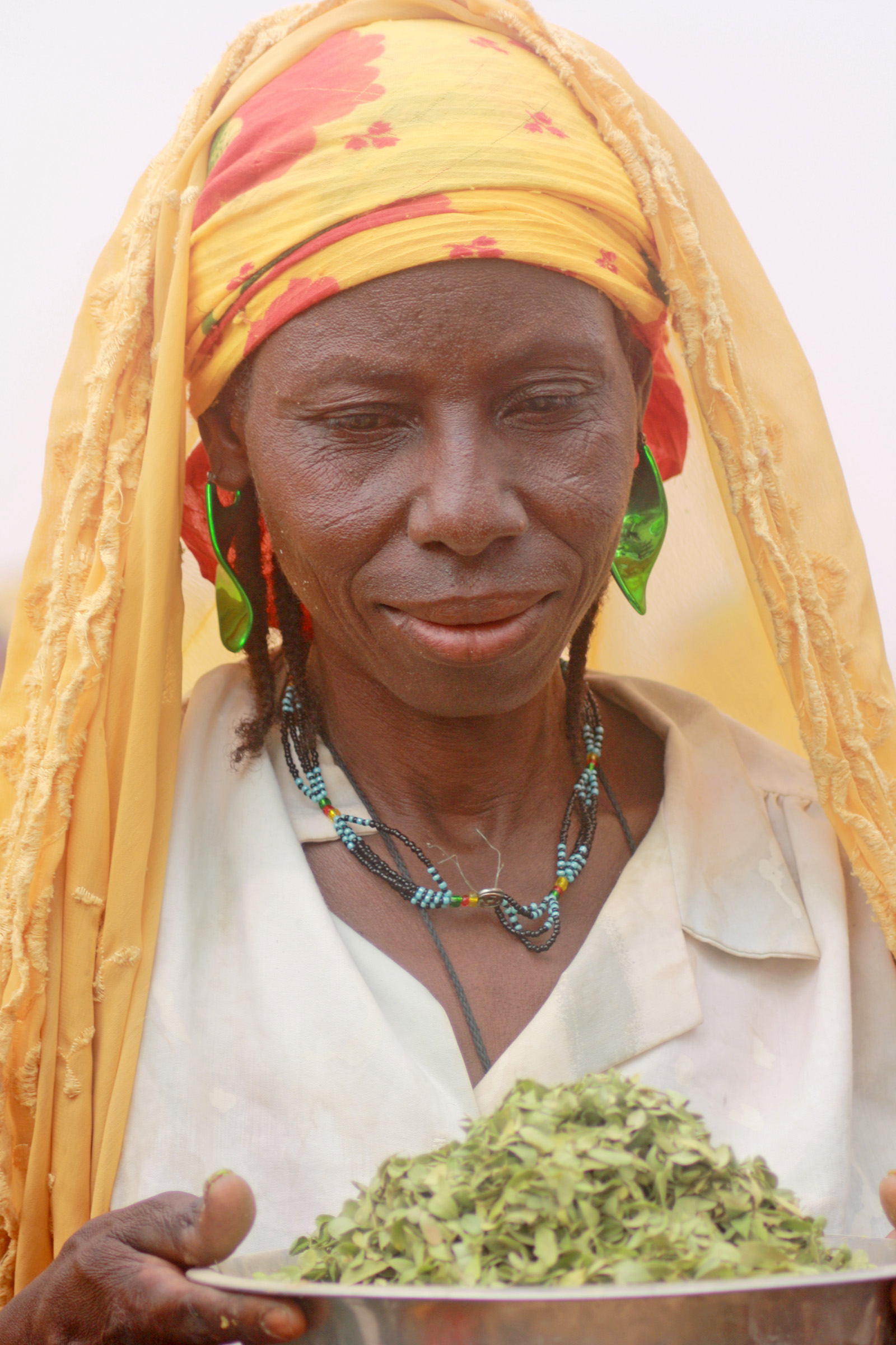Hani Issa from Talkadabey village in Oullam district in Niger's Tillaberi region shows the wild leaves her family has been surviving on since last year