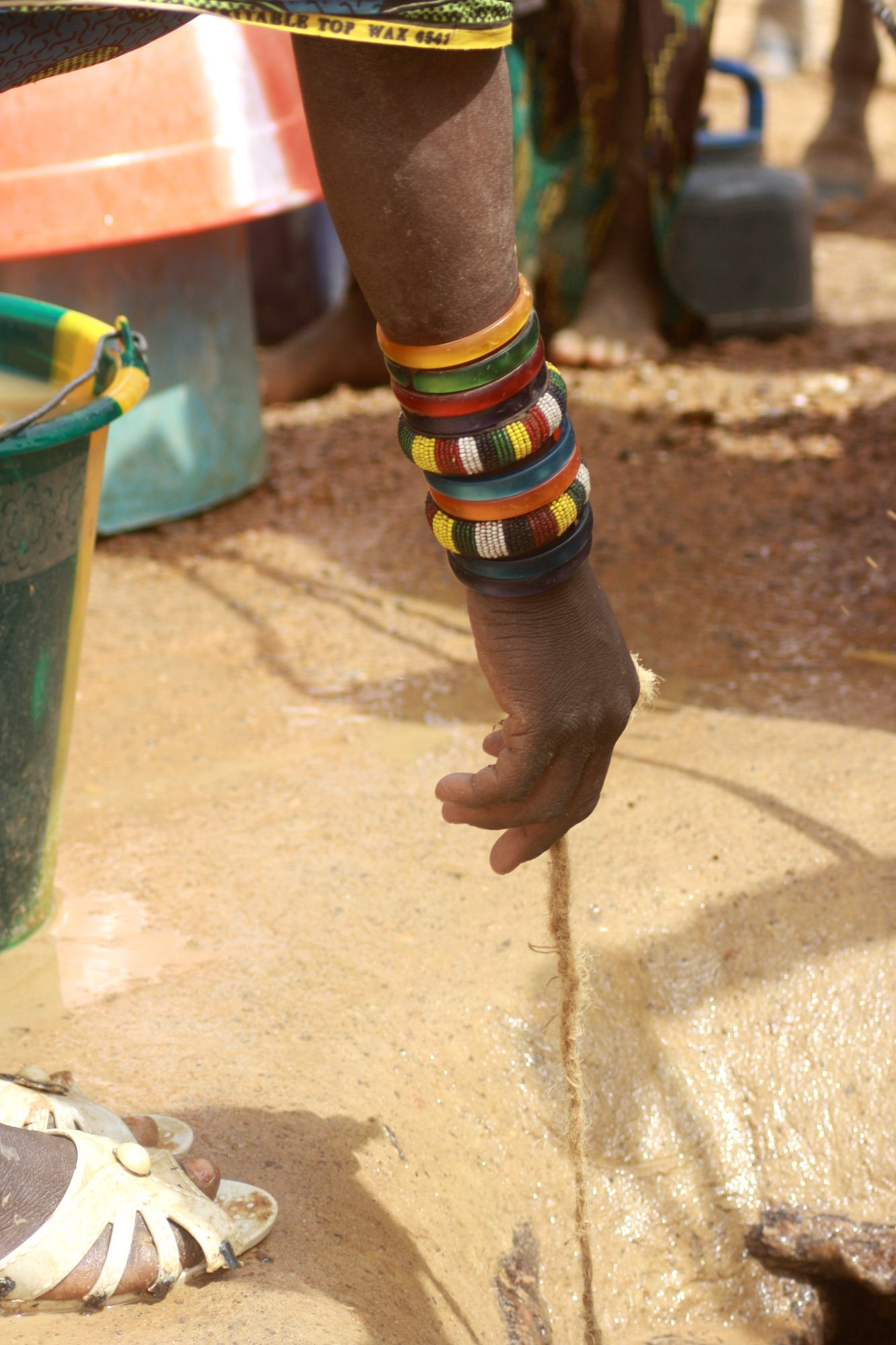 A Tuareg woman draws water in the Gaoudel village in Ayorou District in Niger's Tillaberi region