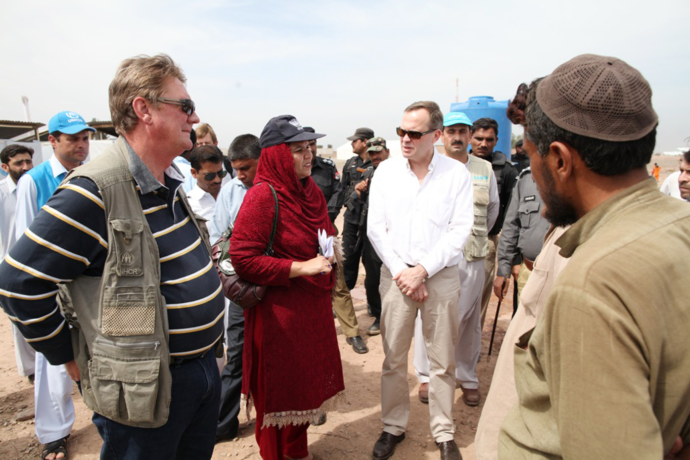 A UNHCR team talks with new arrivals at Jalozai Camp