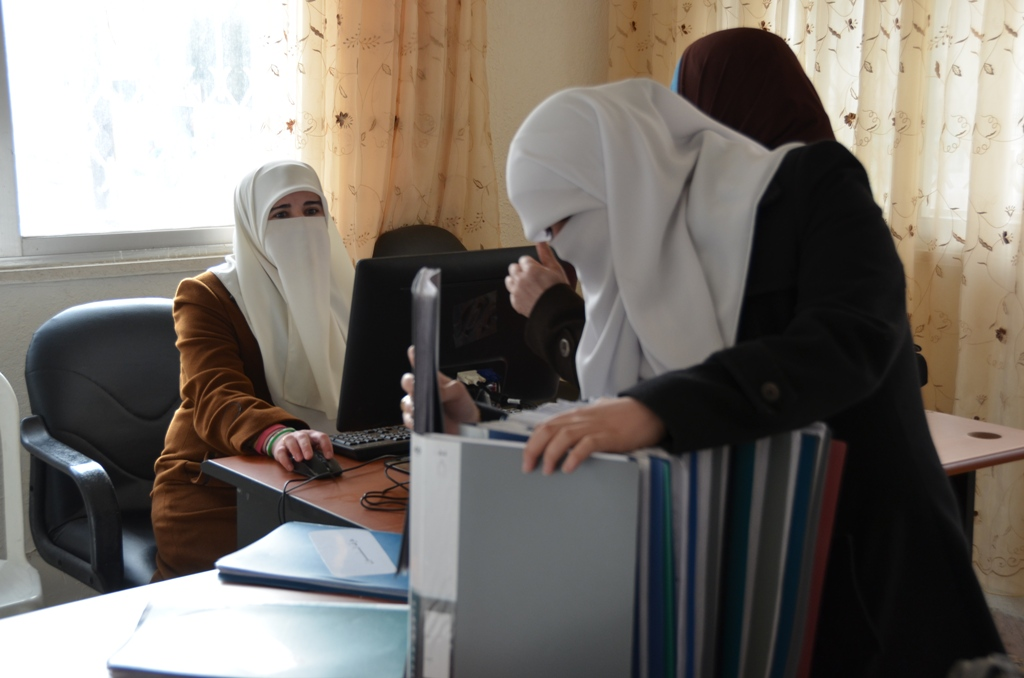 Members of the Syria Woman Association at their office in Amman. The group is made up of Syrians who fled to Jordan in the 1980s, and are now heavily involved in helping the new wave of Syrian refugees in Jordan. Its members are reportedly linked to the M