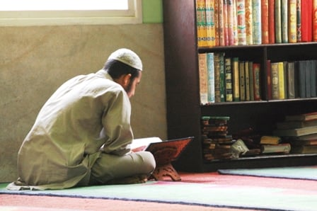 A Muslim student reciting the Qur'an in the late afternoon at the Jami Masjid in Kathmandu