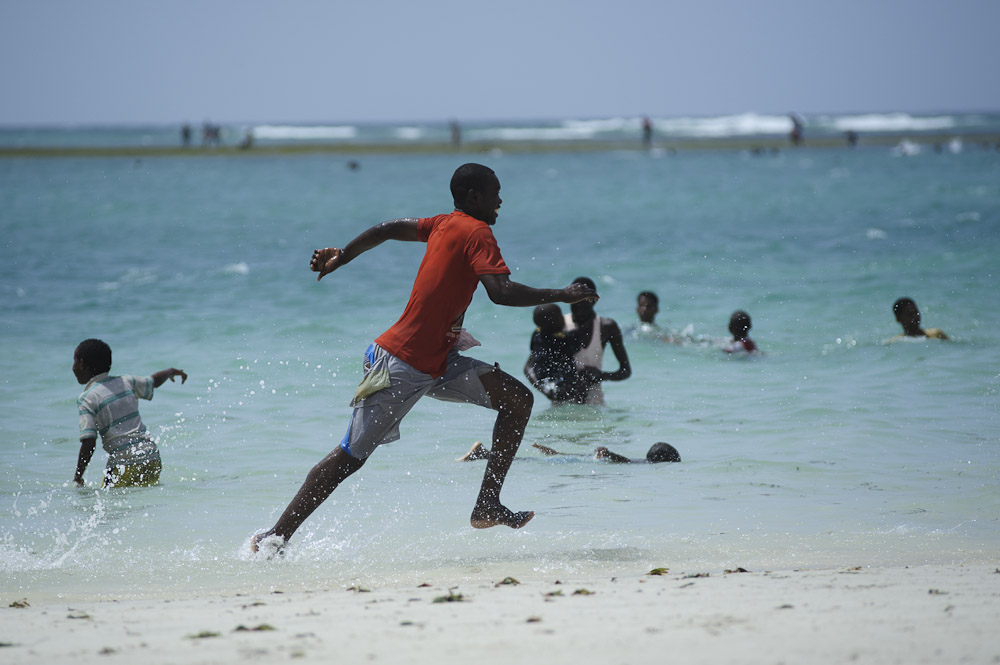 A boy runs through the Indian Ocean at Lido beach in Mogadishu on March 9, 2012. Increased security and stability in Mogadishu has led to a resurgence in life in the city
