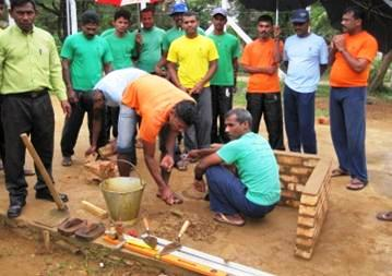 A group of former LTTE fighters learn masonry skills as part of the government's rehabilitation efforts. More than 10,000 men have gone through the programme