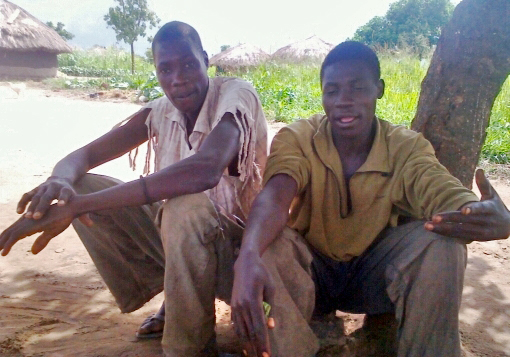 Godfrey Arop (R) and Simon Opio (left), former LRA combatants in their village in Paicho sub county, Gulu district