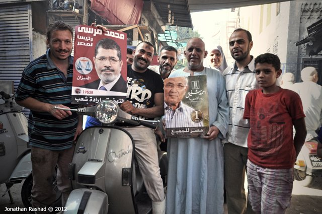 Egyptian voters holding up posters of the two presedential candidates in Cairo on June 16 2012