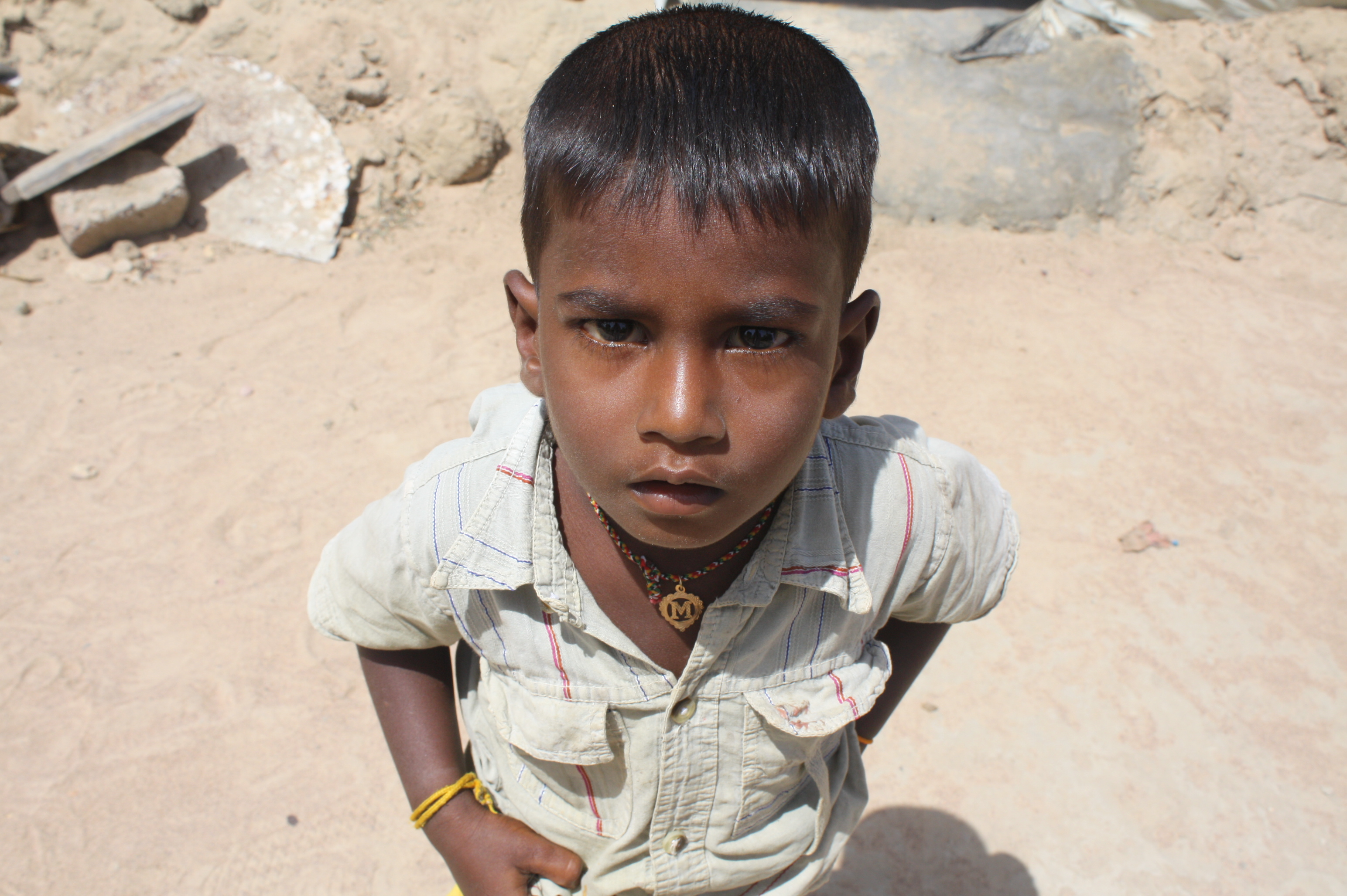 A young boy looks to the camera in the village of Malayalapuram outside Kilinochchi. Thousands of conflict-displaced have returned to the area since the end of Sri Lanka's decades-long war which ended in May 2009