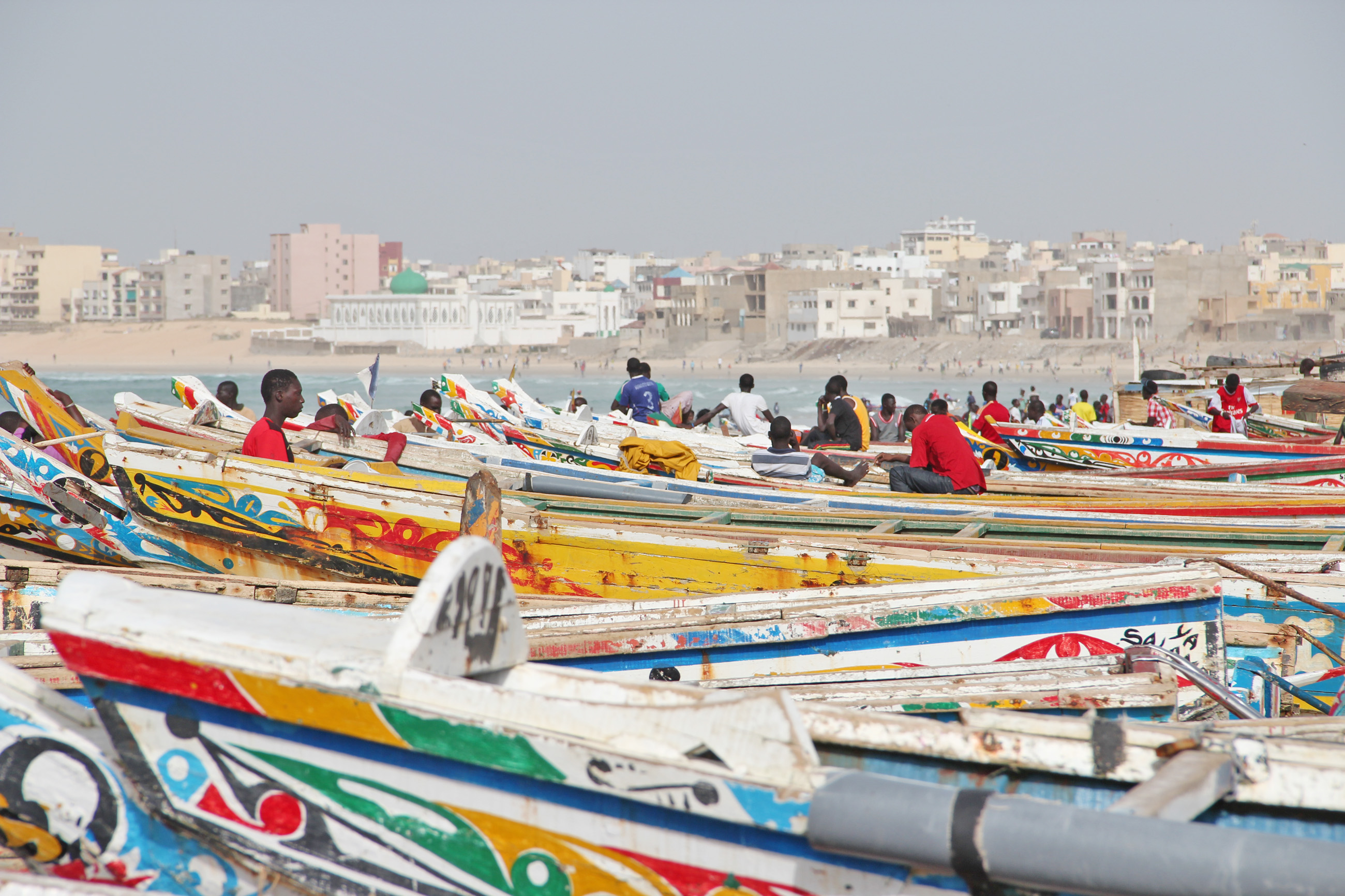 Artisanal boats moored on a beach in Dakar, Senegal. The UN Food and Agriculture Organisation estimates that there were around 16,000 small fishing boats in Senegal in2011, from just about 5,000 in 1982. Local fishermen have also been blamed for overfishi