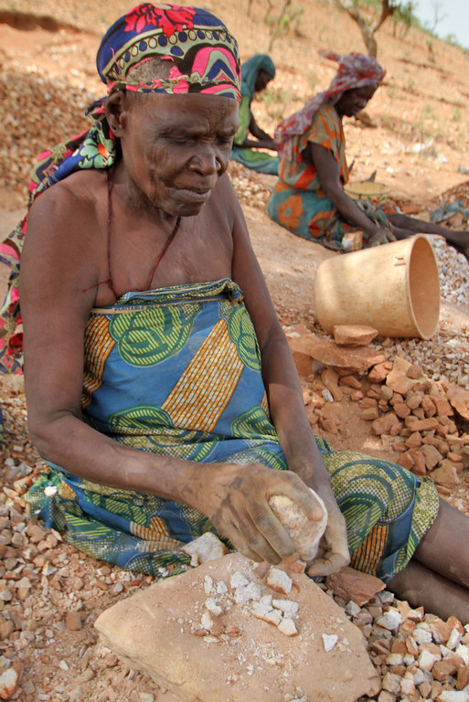 Older women in the Koloma IDP camp in Goz Beida, Eastern Chad, break rocks to make gravel, which sells at $3 a bag