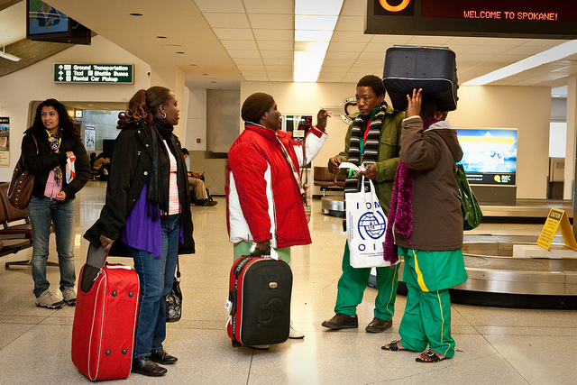Congolese family arrives at an airport in Spokane, US, and are greeted by their caseworker and volunteers
