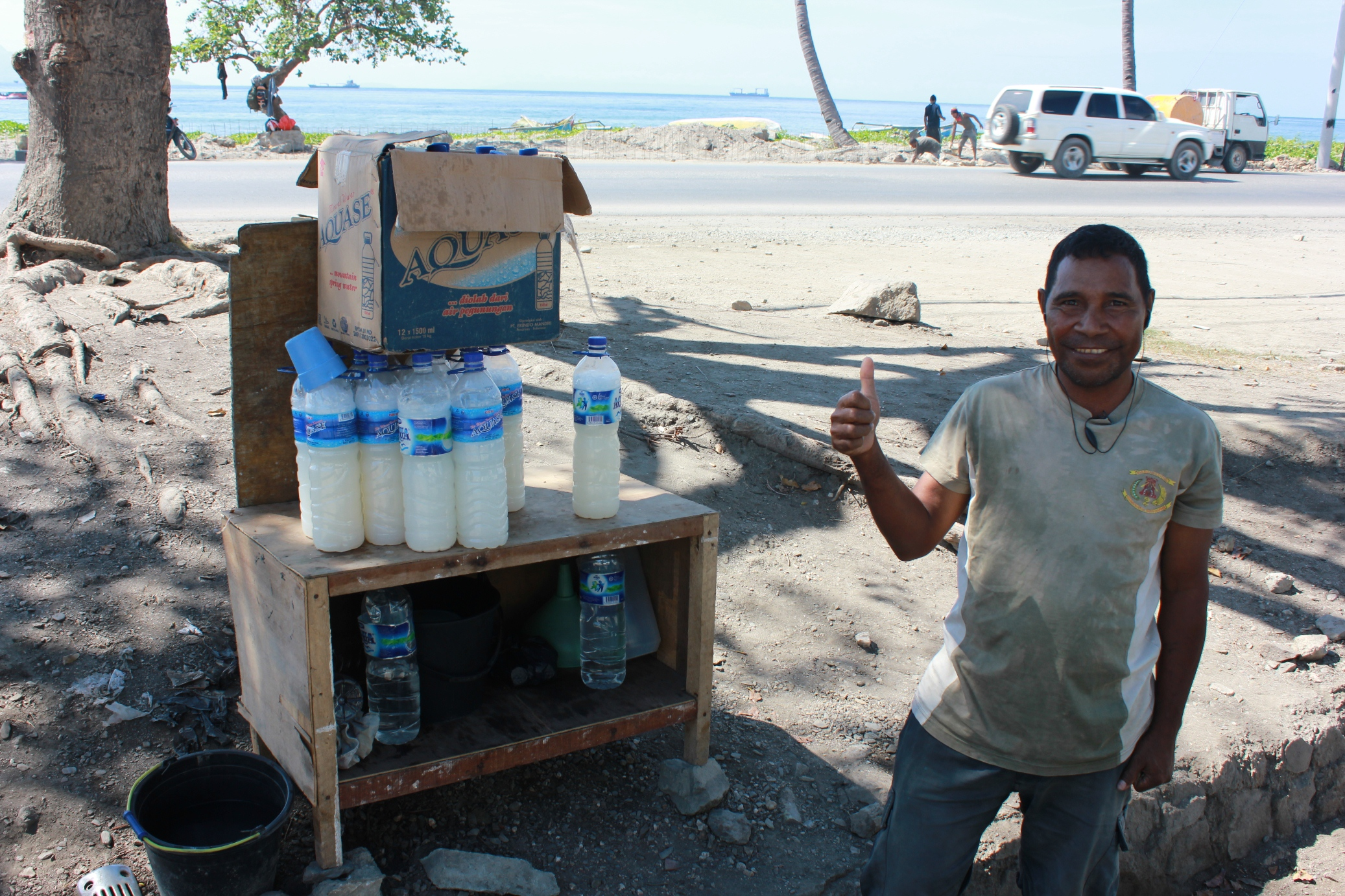 Local palm wine, tua mutin, sold along roadside in Timor-Leste. Alcohol-fuelled violence is a growing concern for officials though data is scarce