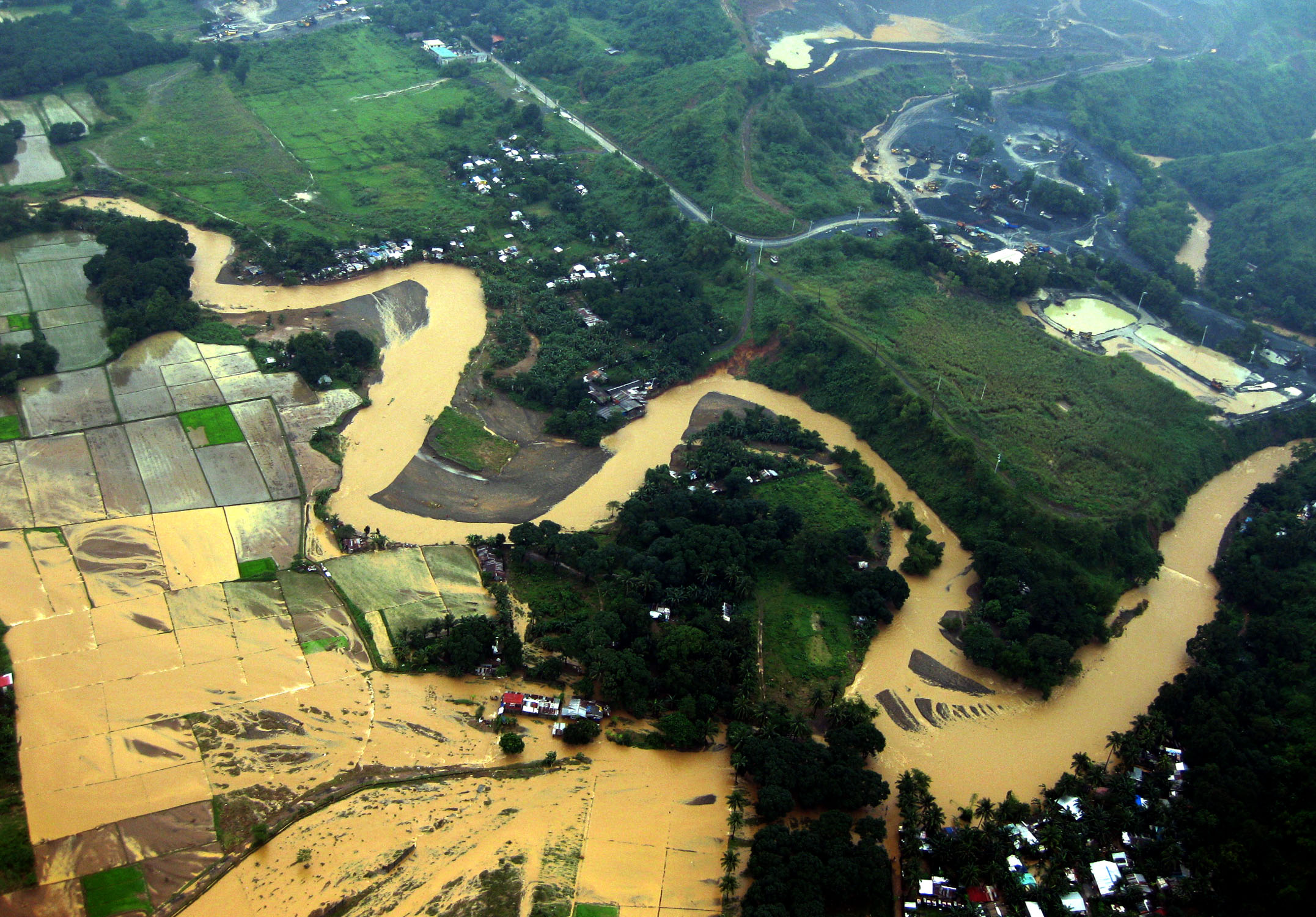 An aerial view of the Marikina district east of Manila and the swollen Marikina river that flooded many riverside communities