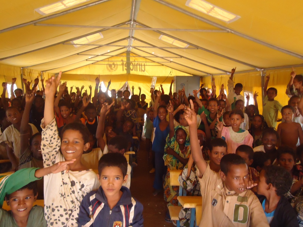 Primary school children in temporary schools set up by NGO Plan International and UNICEF in refugee camps for Malian refugees in Burkina Faso