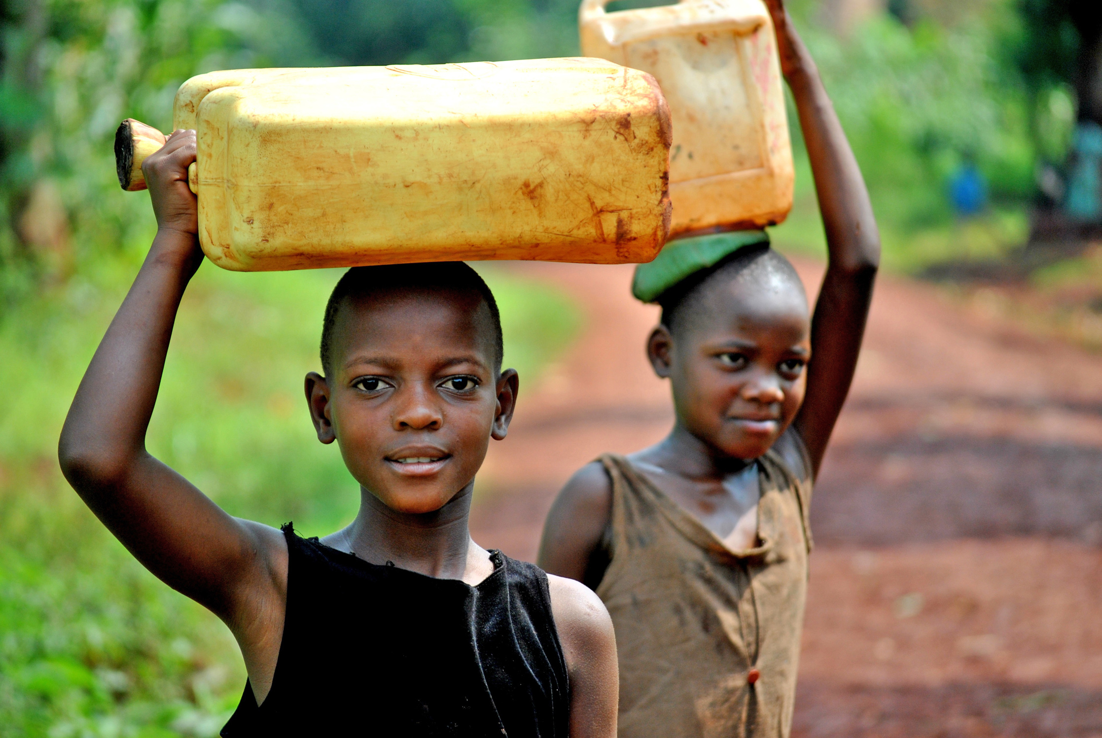 Girls from Beweda village in southwestern Uganda, where women and girls walk over 8km daily to fetch water (Dec 2011)