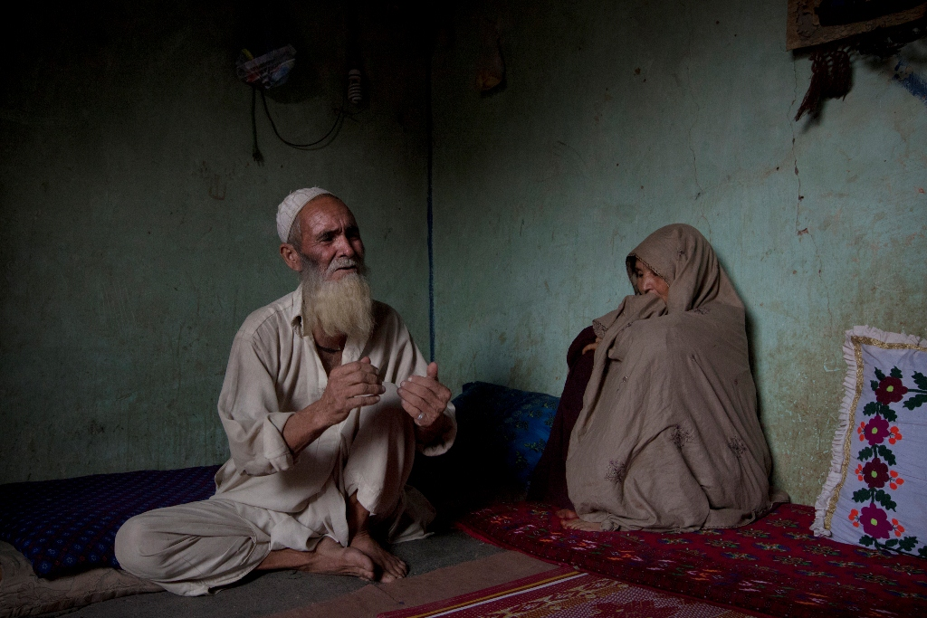 Mohammad Issa, a 70-year-old Afghan refugee, sits with his wife Zeitoon Bibi, 55, in the Dhok Choorah makeshift settlement on the outskirts of Islamabad on August 20, 2012. He does not know what he will do when his Pakistan-issued Proof of Residency card