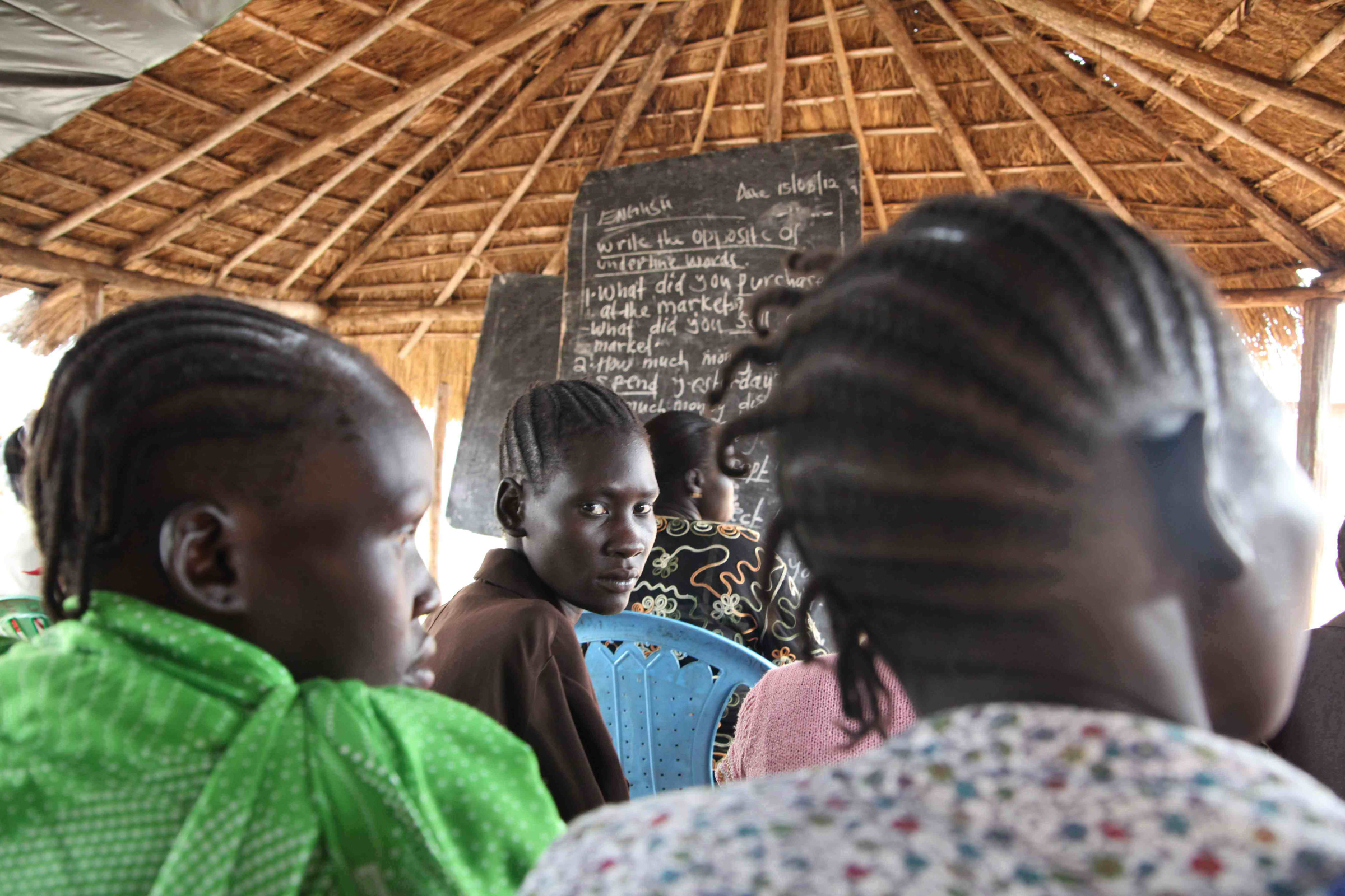 Women attend an adult learning programme at a primary school in Yei, near South Sudan's border with Uganda. Only 16 percent of the country's women are literate