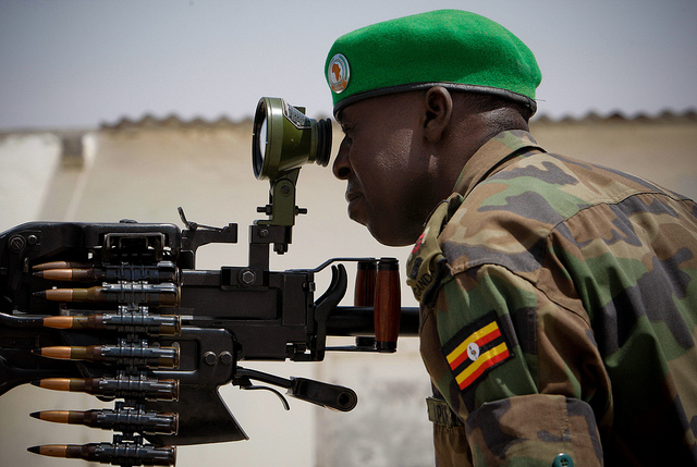 A Ugandan officer serving with the African Union Mission in Somalia (AMISOM) ranges a scope on a heavy machine-gun mounted on the roof of Mogadishu University 23 January. AMSIOM and Somali National Army (SNA) forces have consolidated newly captured positi