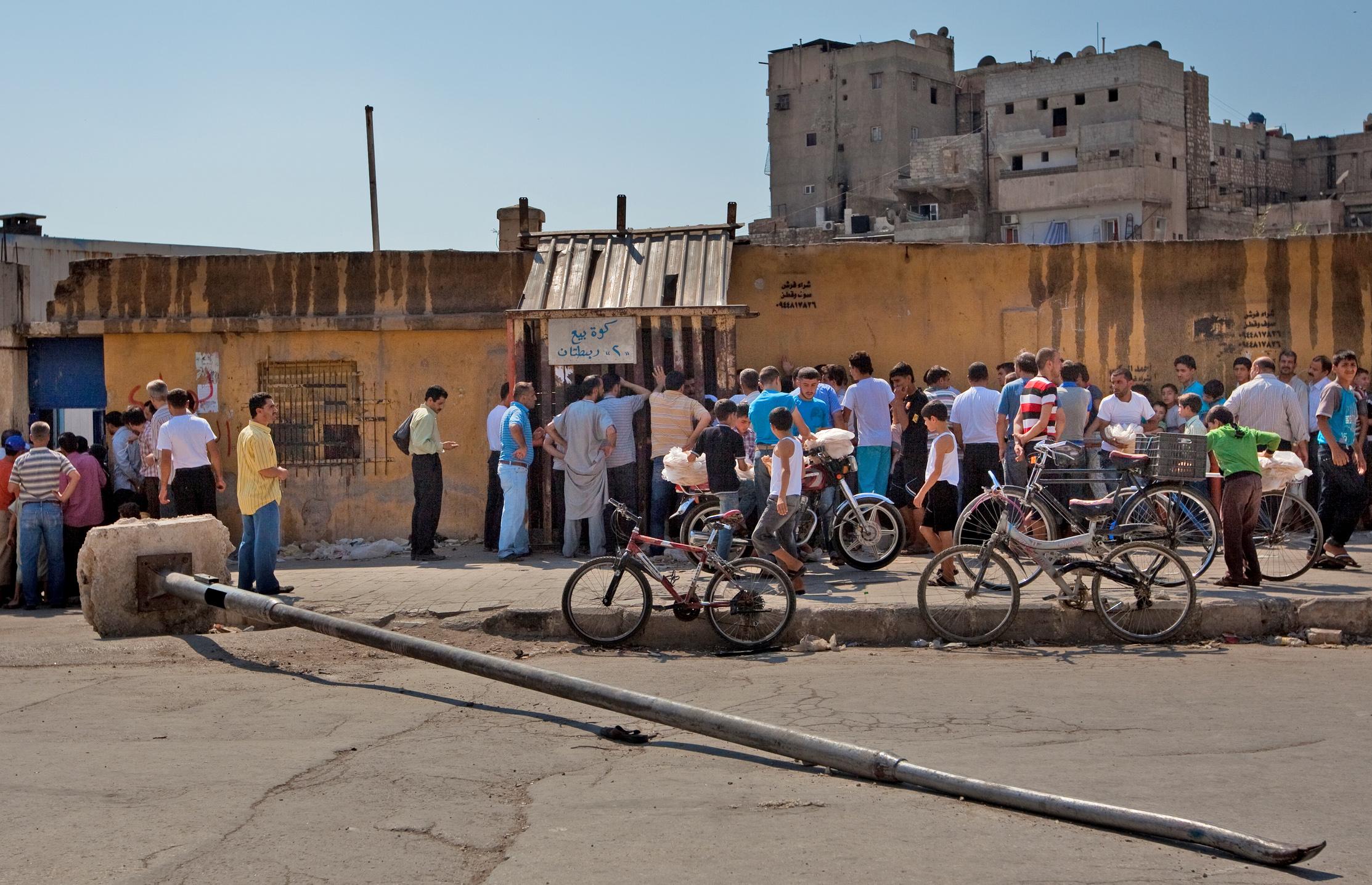 People queue to buy bread in Aleppo, Syria
