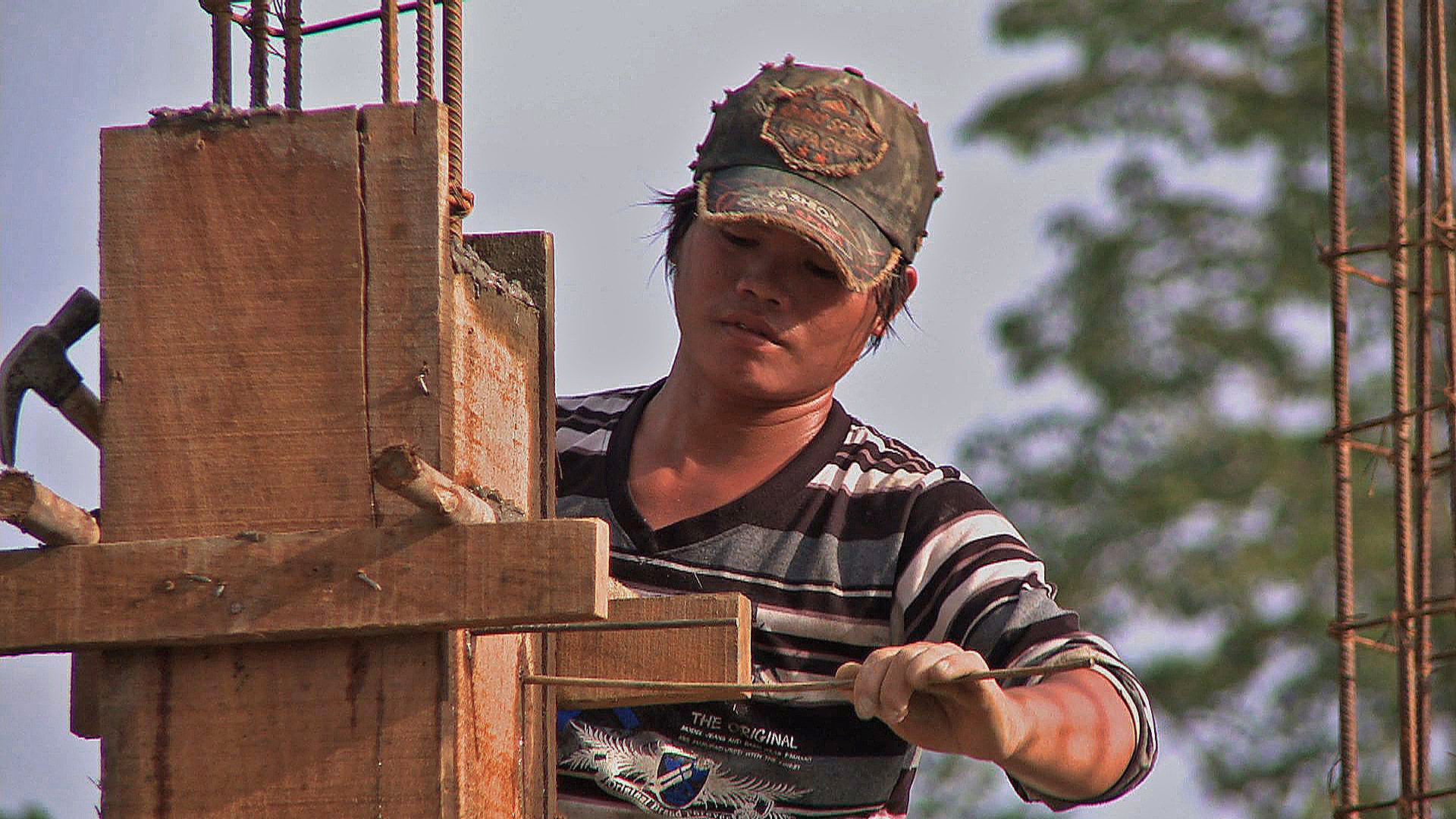 A Burmese construction worker in Chiang Mai. There are more than 2 million labour migrants in Thailand, mostly from neighbouring Myanmar