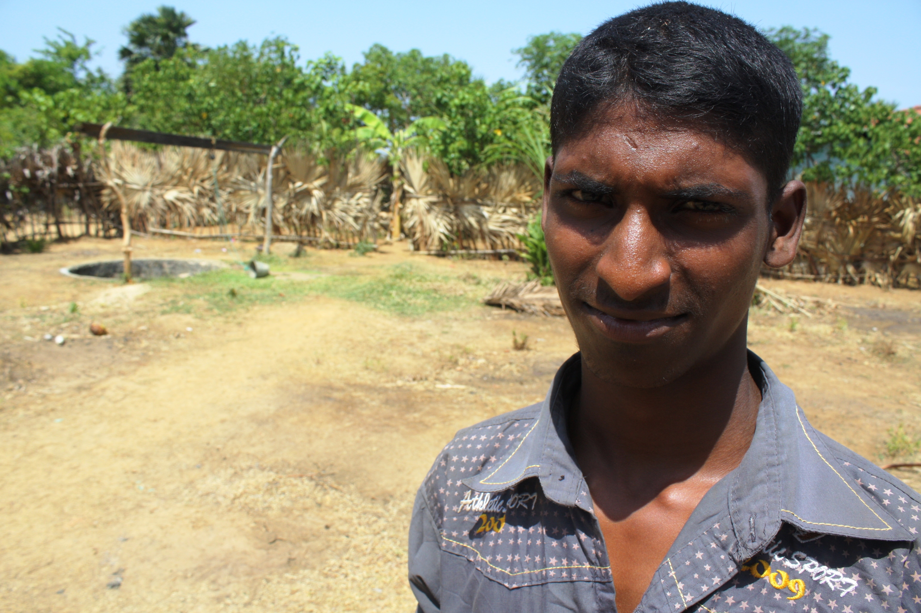 A young man looks to the camera in Jaffna, northern Sri Lanka. Unemployment is rife amongst young people in the former conflict zone