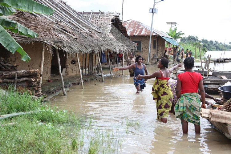 Women lamenting their plight as a result of rising water levels in Toru-Orua in Sagbama local government area of Bayelsa state. September 2012. The National Emergency Management Agency, NEMA, estimates 1.3 million Nigerians were displaced by floods this y