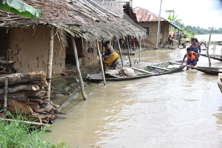 Women with a dug-out canoe in front of their flooded homes in Toru-Orua in Sagbama local government area of Bayelsa state , September 2012. The National Emergency Management Agency, NEMA, estimates 1.3 million Nigerians were displaced by floods this year,