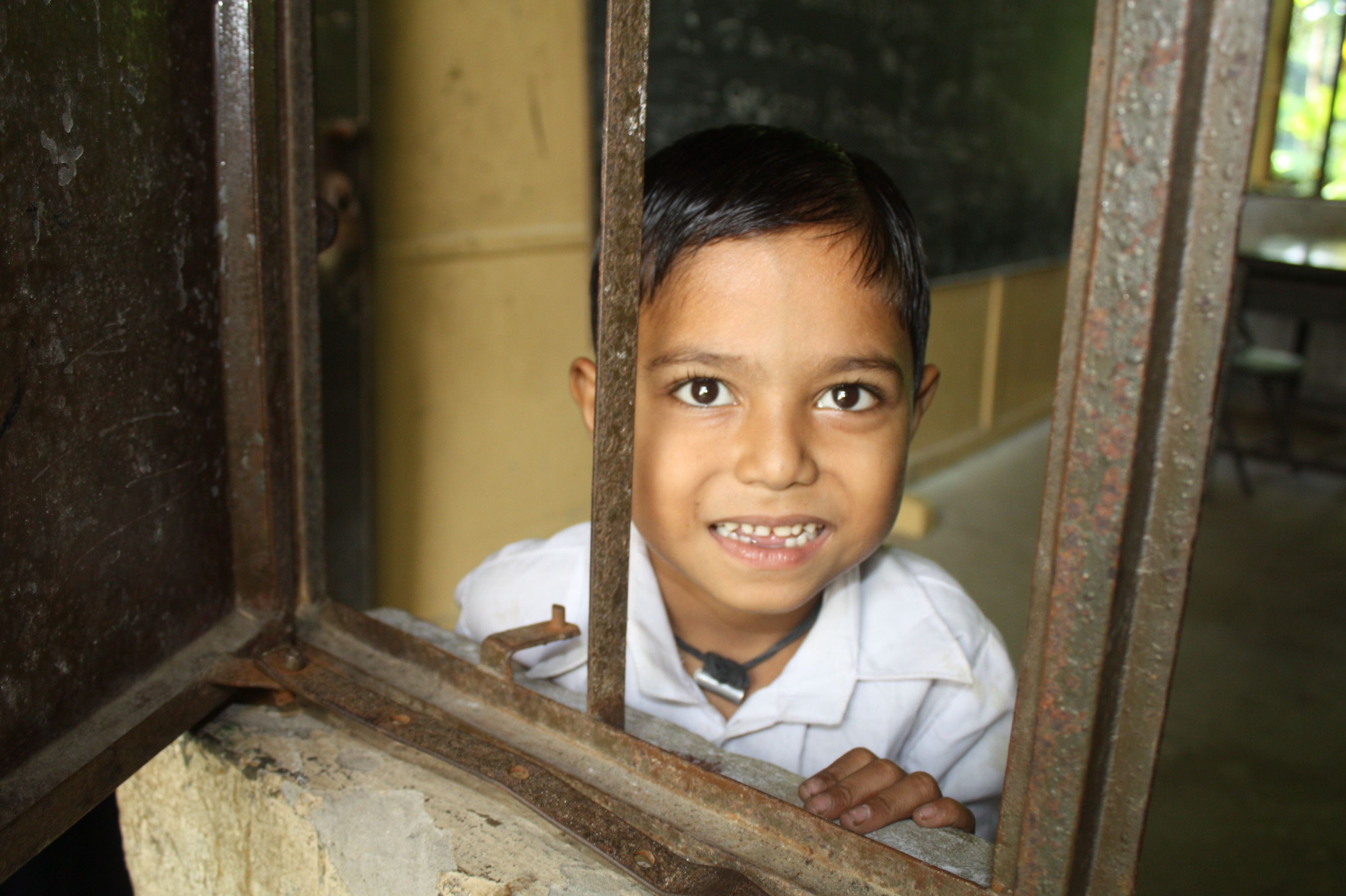 A young boy looks to the camera from his classroom in Chittagong, southeastern Bangladesh