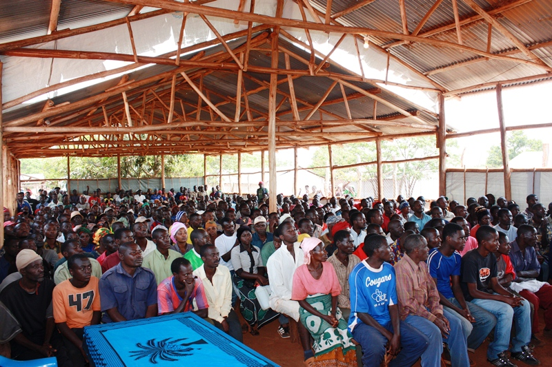 Burundian residents of Mtabila camp in Tanzania attend a mass information meeting about their recent loss of refugee status