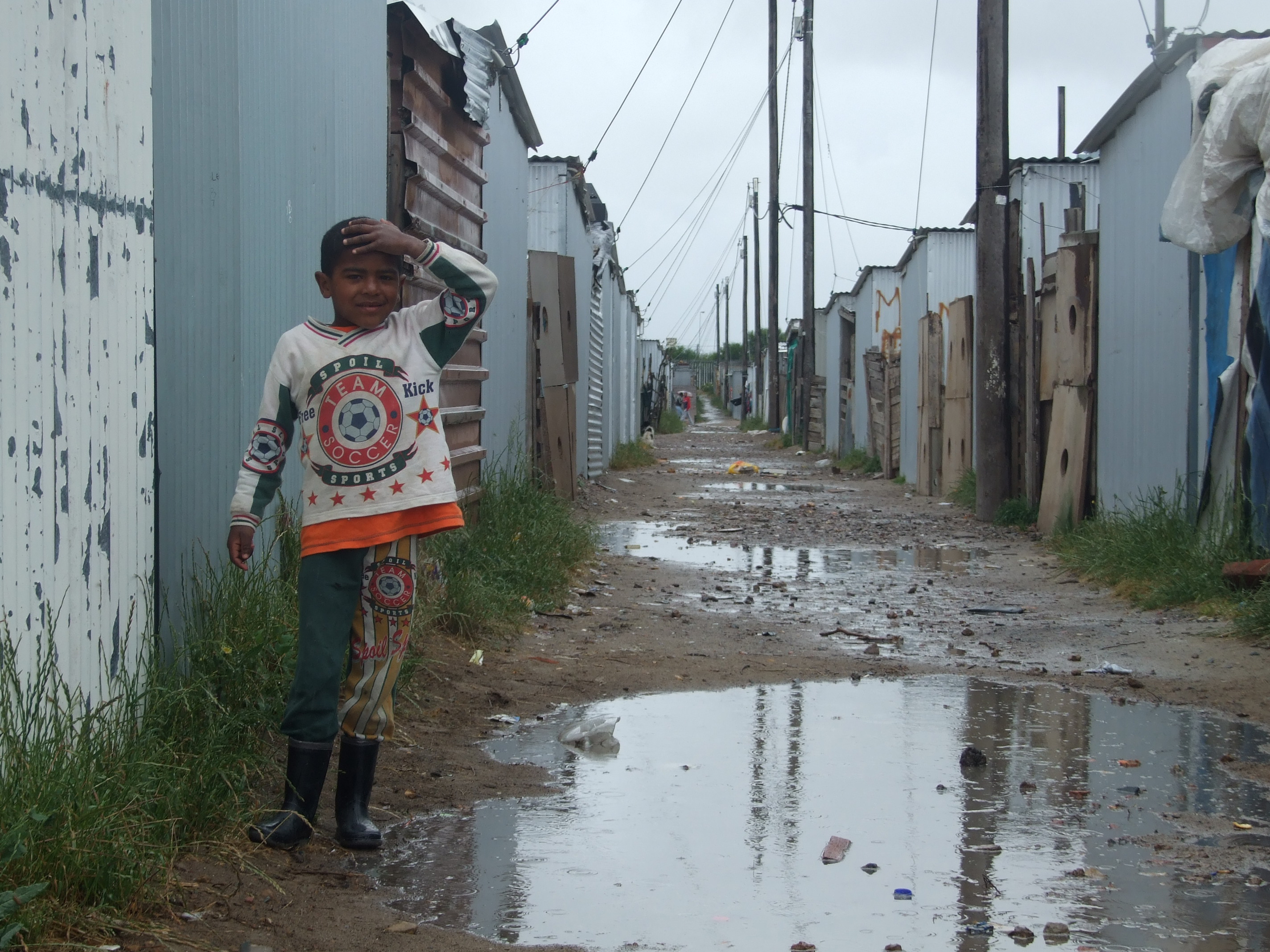 A child on the streets of Blikkiesdorp, near Cape Town, South Africa