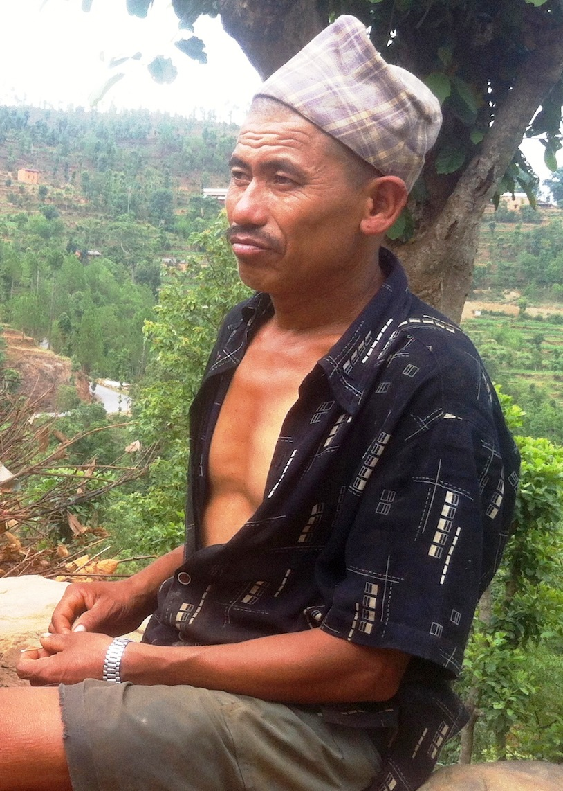 Maize farmer Manbahadur Tamang, 40, is struggling to feed his family after losing his maize crop to monsoon rains in June 2012 in rural Sindupalchok District