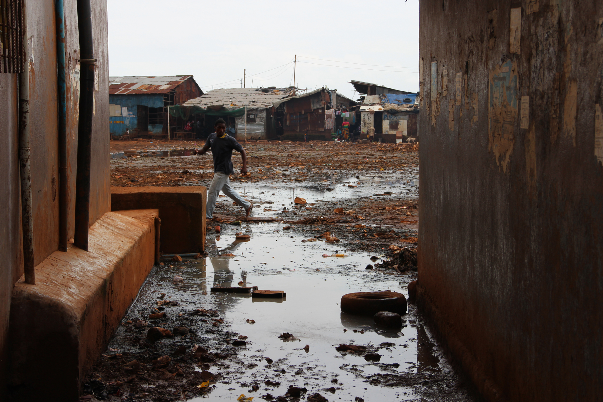 Congested Freetown slums with inadequate safe water, sanitation and hygiene were the worst affected