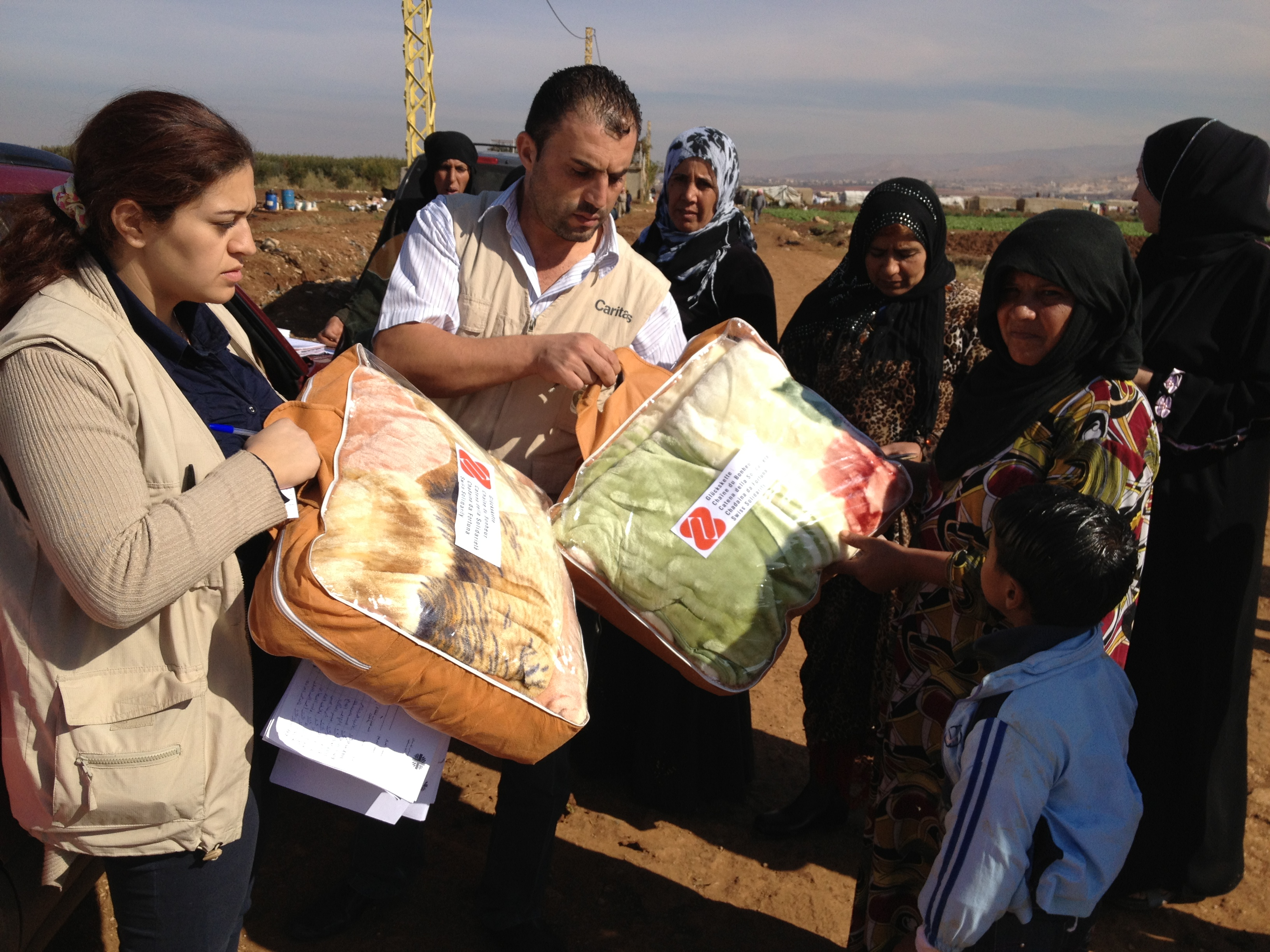 Caritas distributing aid (blankets) to Syrian Refugees facing a cold winter in the Bekaa Valley, Lebanon November 11th, 2012
