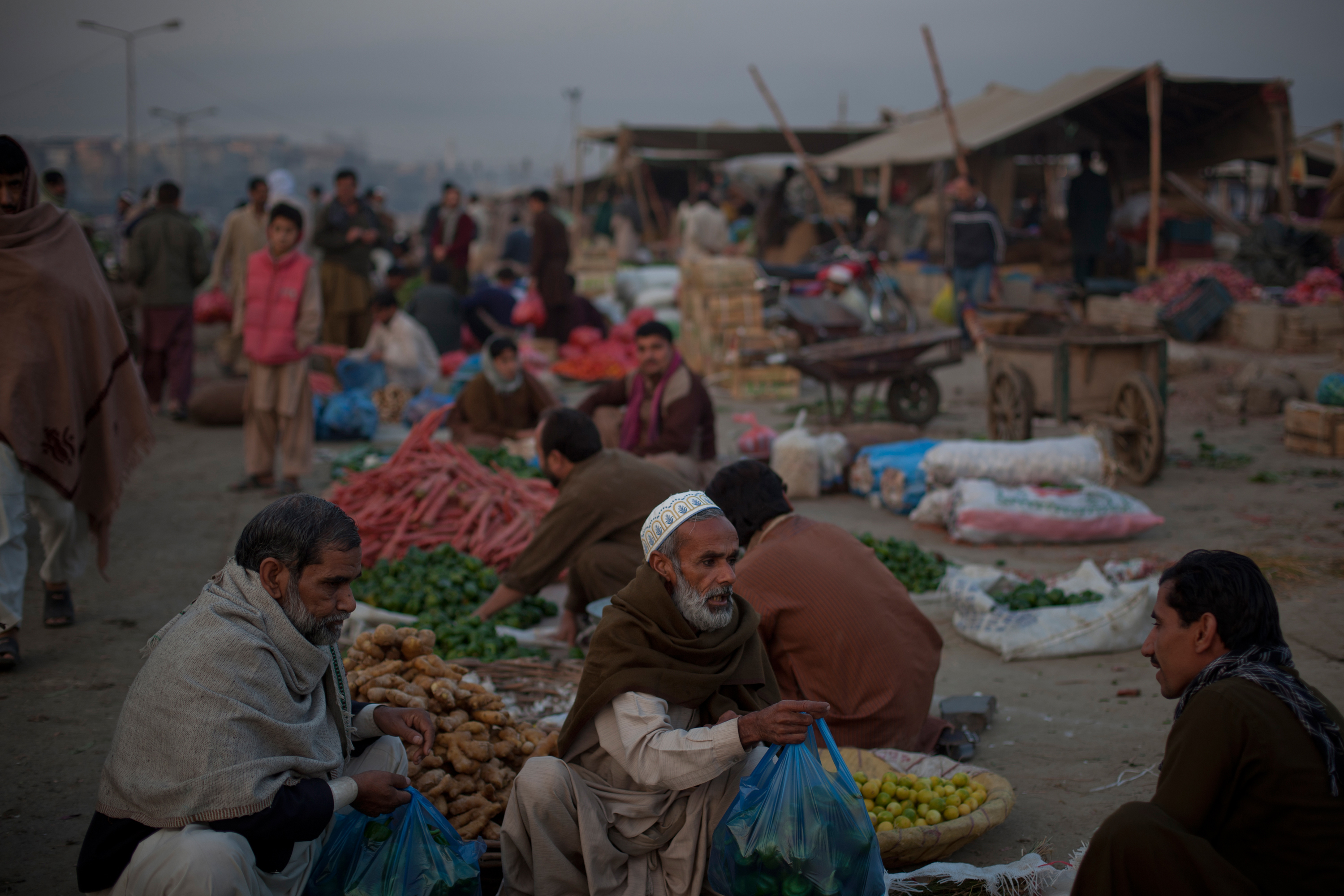 Market sellers in Islamabad, Pakistan, struggle with high food prices